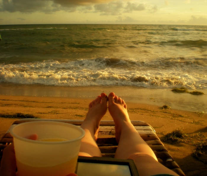 I'm relaxing at Shipwreck Beach Bar and Grill on St. Kitts, with a mimosa in one hand and my kindle in the other. What more could you ask for?